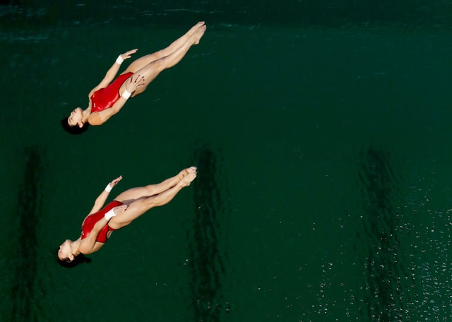 China's Chen Ruolin and Liu Huixia compete during the women's synchronized 10-meter platform diving final in the Maria Lenk Aquatic Center at the 2016 Summer Olympics in Rio de Janeiro, Brazil, Tuesday, Aug. 9, 2016. (AP Photo/Matt Dunham)
