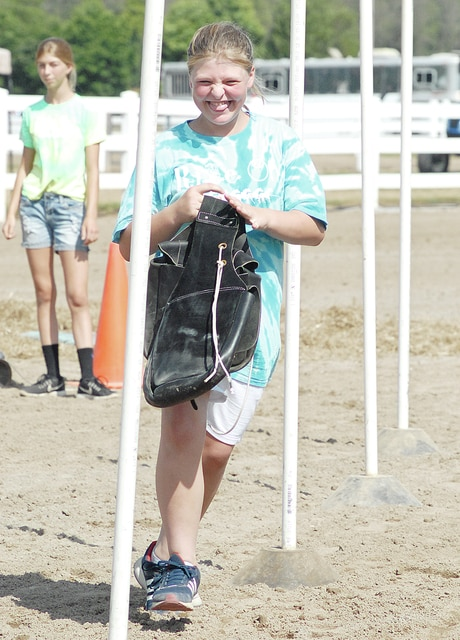 Anthony Weber   Troy Daily News Members of the Ride On 4-H Club, including Skyler McLain, compete in the Pony Express obstacle course during the Super Stars event Friday at the horse arena during the 2016 Miami County Fair.