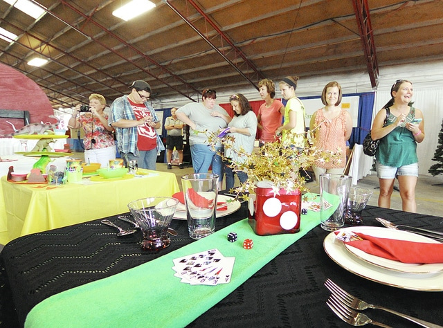 Anthony Weber | Civitas Media Fair-goers crowd inside the Merchants Building as judging for Tablescaping gets under way Friday during the opening day of the 2016 Miami County Fair.