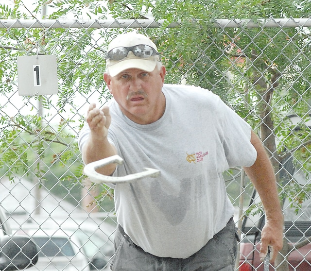 Anthony Weber   Civitas Media Neil Teaford competes in the Horseshoe Pitching Tournament Saturday at the 2016 Miami County Fair.