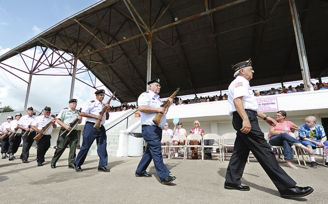 Anthony Weber | Troy Daily News Members of the Veterans of Foreign Wars Post 5436, American Veterans Post 88 and Clifford Thompson American Legion Post 43 prepare to conduct the Presentation of Colors during a Salute to Veterans ceremony Wednesday at the stadium during the 2016 Miami County Fair.