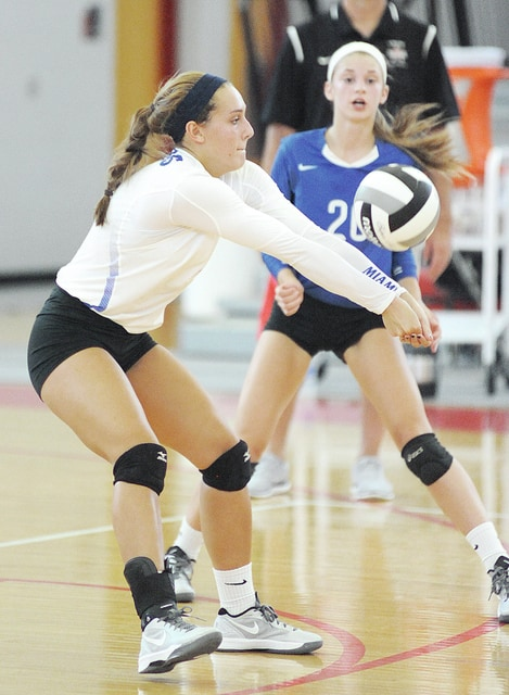 Anthony Weber | Troy Daily News Miami East's Jillian Wesco (6) passes the ball as teammate Sophie Jacomet looks on Saturday at Troy.