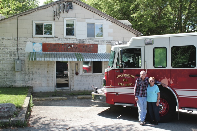 Provided photo Jr. and Tootie Gilmore stand in front of their store with the Lockington new fire engine.