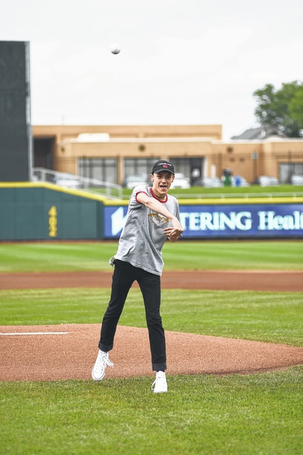 "Kevin Fultz, 17, of Sidney, throws out the first pitch of the Dayton Dragons baseball game on Aug. 16. The first pitch was part of Life Connection of Ohio's donor awareness night at the game. Fultz honored his dad, Michael Keith Fultz, who died in April. His organs were donated to others through Life Connection of Ohio. ""All summer long, the community comes to Dragons games to be together and cheer as one, so when we've got the ability to come together and honor the Fultz family for the lifesaving gift that Kevin's father Michael gave, it's extra special. It's truly humbling to see the good that's out there in our world when all too often we only hear about the bad that's out there,"" said Brad Eaton of the Dayton Dragons. Fultz is also the son of Pam Fultz."