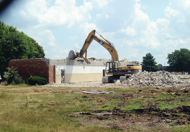 Mike Ullery | Daily Call Demolition crews have been working on tearing down the former Covington Elementary School and Intermediate School buildings this week. When school begins at the end of the month, students will be attending the new building located to the east of the old buildings. A number of Covington residents have made frequent pilgrimages to the site to watch the demolition process and reminisce about old times.
