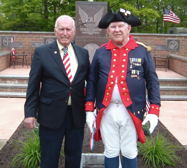 Provided photo Pictured is Bill Ellerman, right, representing the SAR and Chuck Morrow in front of the veterans memorial monument.