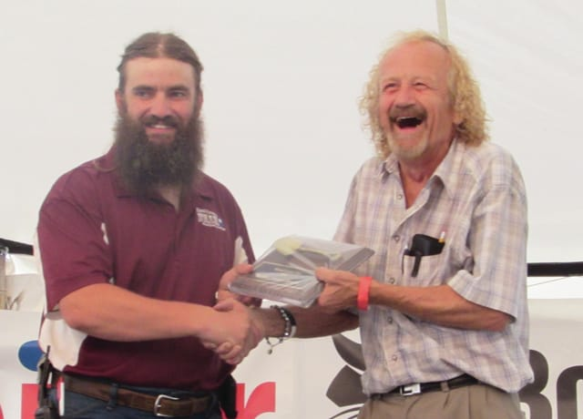 Sam Wildow | Daily Call Barrie Vankirk of Covington (right) received the Golden Trowel Award at the Miami County Fair on Sunday.