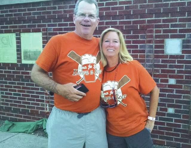 """Provided photo Jim Burkhardt, also known as """"Dr. Beer,"""" along with wife Cheryl, are the organizers of Down The River, Down A Beer. Now in its third year, the event will take place from 6-10 p.m. Saturday at Lock Nine Riverfront Park in downtown Piqua."""