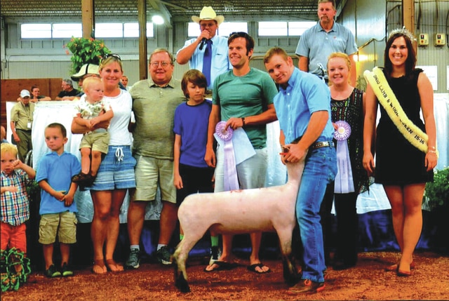 Provided photo Justin Parke, the son of Brian and Shon Parke of Covington and a member of the Premier Livestock Club, exhibited the Reserve Champion Brockle-Face Market Lamb on July 27, at the Ohio State Fair. He competed against 216 exhibitors with 668 market lambs. Huffman's Market and the Ohio Club Lamb Boosters purchased Justin's lamb for $1,500 at the fair's market lamb sale.