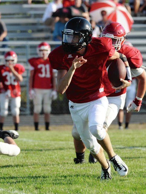 Ben Robinson/GoBuccs.com Covington quarterback Ty Freeman runs with the ball Monday.