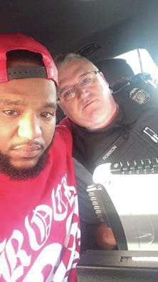 "Courtesy of Mark E Ross | Facebook ""He gave me hope,"" Mark Ross said of Sgt. Dave Robison after a traffic stop led to prayer and an offer to help Ross get home to his grieving family in Detroit, where his teenage sister was killed in a car accident."