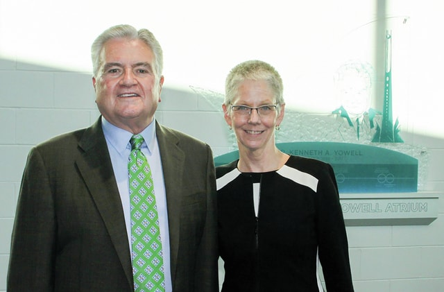 Provided photo Former Edison State President Dr. Kenneth A. Yowell and current President Dr. Doreen Larson stand in front of the commemorative wall display at the college.