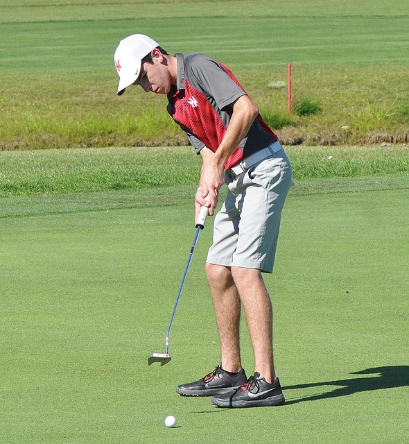Rob Kiser/Call Photo Newton's Chet Jamison watches his birdie putt on the second hole Monday at Echo Hills.
