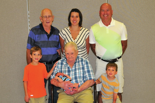Provided photo Ninety-five-year-old Harold Langston Sr., of Sidney, holds his great-great grandson, Ezra Quatman, who was born Sept. 7. Beside him are Ezra's brothers, Bear (left), age 6, and Ivo (right), age 4. Standing behind are: Ezra's mother, Jaime Quatman (center), of Anna; grandfather, Scott Langston (right), of Versailles; and great-grandfather, Harold Langston Jr. (left), of Versailles. The family also has relatives in the Piqua area.