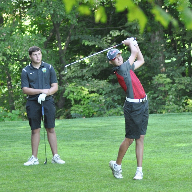 Rob Kiser/Call Photo CCC Player of the Year Nathan Osborne watches his tee shot on the eighth hole as Tyler Weinert of Bethel looks on.