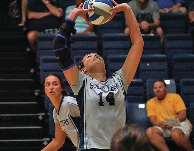 Photo courtesy of Scott Erland/Lincoln Memorial University Sports Communications Lincoln Memorial University senior Abby Cash (front) sets the ball up as sister Sam Cash prepares to put it away. Both sisters graduated from Miami East High School, leading the team to back-to-back Division III state championships in 2011 and 2012.
