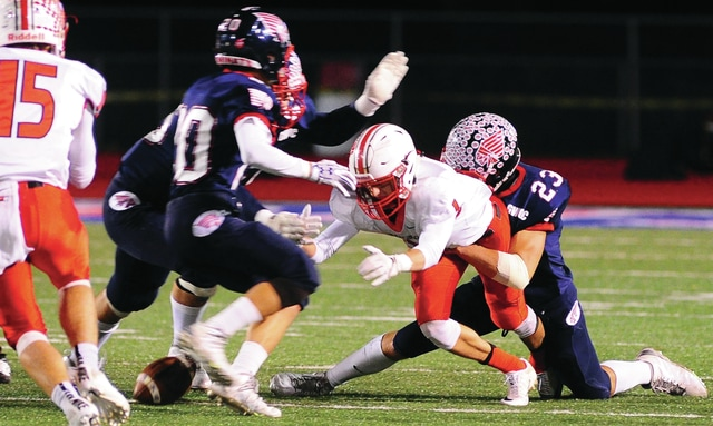 Mike Ullery | Daily Call Ben Schmiesing, 23, forces a Tipp City first-quarter fumble on Friday.