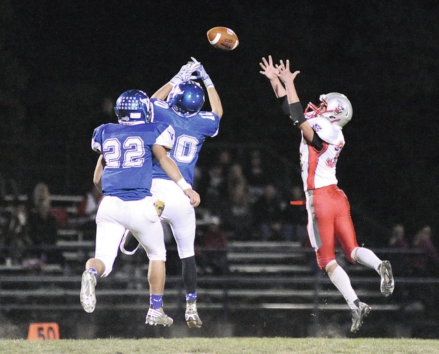 Anthony Weber | Troy Daily News Miami East's Justin Brown (10) deflects a Tri-County North pass Friday in Casstown.