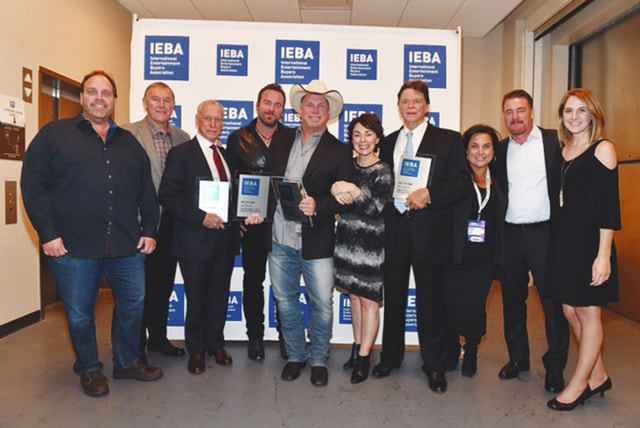 Provided photo Barry Jeffrey, Todd Boltin, Bob Doyle, Lee Brice, Garth Brooks, IEBA's Pam Matthews, Ben Farrell, Risha Rodgers, Rob Beckham, and Monica Copciac pose backstage at the 2016 IEBA Honors and Awards Ceremony during day three of the IEBA 2016 Conference on Oct. 11, in Nashville, Tenn.