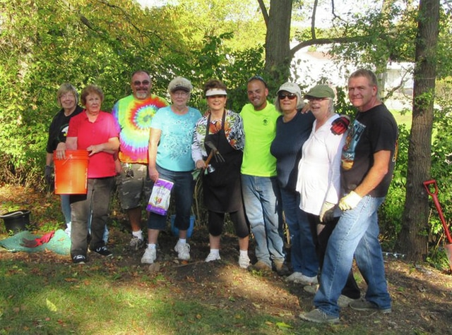 Provided photo The Green Leaf Garden Club planted four different types of daffodils along the bike path just above French Park on Oct. 17. They were assisted by a city park employee and four members of the community. Pictured are Penny Adams, Karen McNeil, Artie Parker, Judy Quinter, Betty Thompson, Ben Gover, Karen Raggon, Teckla Powell and Roland Kellar. Also assisting with the project were Ruth Cameron and Bill McNeil. Previously, club members had cleared the area of honeysuckle and debris. The ground being an old railroad bed, workers found the digging to be quite difficult and used spades, drills and a pick axe to make the holes for the bulbs, finding two rails from the railroad buried, which were sent to the city's recycling area. After adding peat moss and fertilizer, they planted 775 bulbs, which will bloom in the spring of 2017. There are plans to remove the rest of the honeysuckle and plant more bulbs next year.