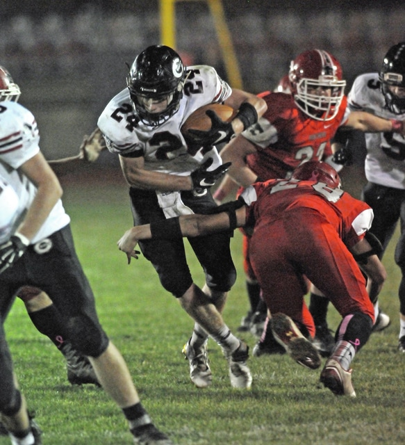 Ben Robinson/GoBuccs.com Branden Robinson weaves his way through traffic in a win over Twin Valley South Friday night.