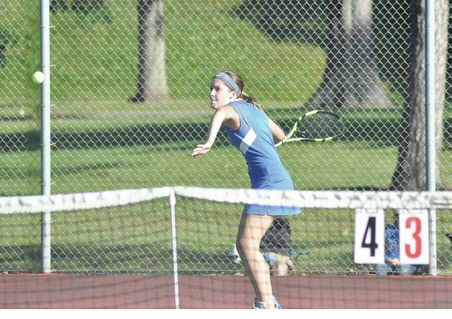 Rob Kiser/Call Photo Lehman's Claire Larger eyes a forehand return Tuesday at Troy City Park in Division II sectional action.