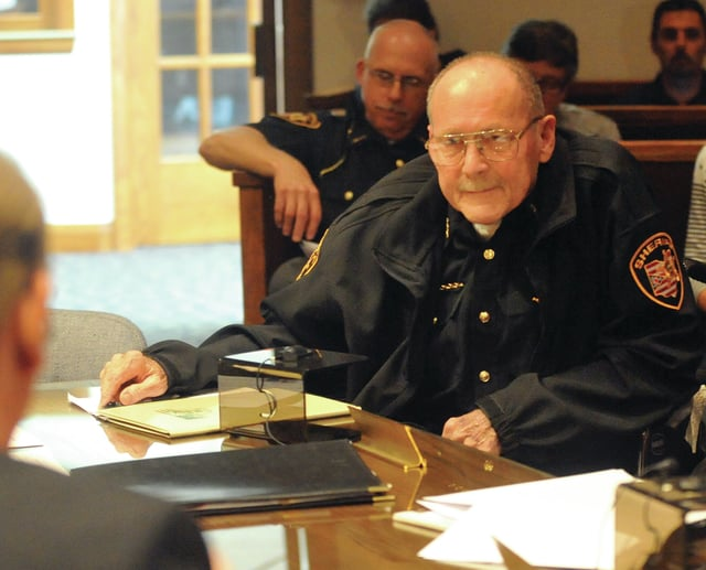Mike Ullery | Daily Call file photo Miami County Sheriff Charles Cox at a Miami County Commission meeting in 2015. Cox, who has been sheriff for the past 28 years, passed away this morning.