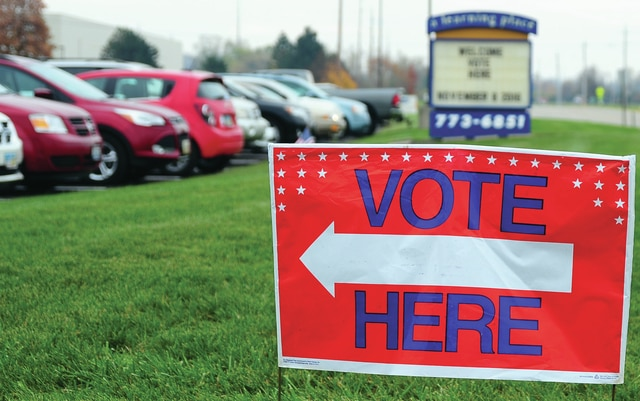 Mike Ullery | Daily Call Parking lots are crowded at A Learning Place as Piqua voters cast their ballots on Tuesday morning. In spite of a large voter turnout, poll workers say that lines are moving quickly and the wait for voters is minimal.