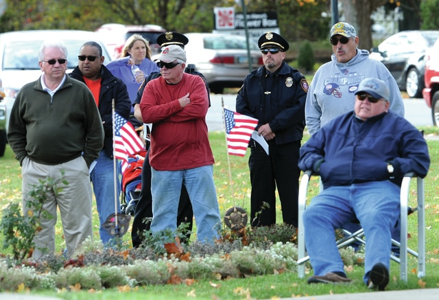 Mike Ullery | Daily Call Piqua city officials, police officers, firefighters and a number of veterans gathered at the Piqua Veterans Memorial for a Veterans Day ceremony on Friday.