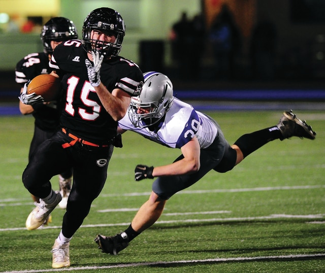 Mike Ullery | Daily Call Covington's Lance Miller, 15, eludes a Fort Recovery defender.