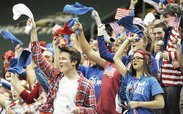 Anthony Weber | Troy Daily News Sporting a red, white and blue theme on Veterans Day, the Miami East student section cheers on the Vikings during the Division III state semifinal match against Gilmour Academy at the Nutter Center Friday in Fairborn.