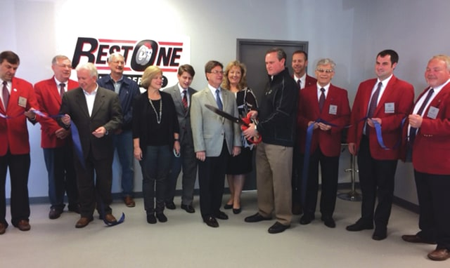 Provided photo Ambassadors from the Piqua Area Chamber of Commerce, along with City Manager Gary Huff, Mayor Kazy Hinds and Chamber President R. Scott Miller, welcome Best One Tire and Service to Piqua during a recent ribbon-cutting ceremony. The business is housed in the 10,400-square-foot former Goodyear Tire building at 1246 E. Ash St.