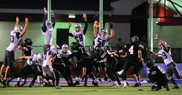 Fort Recovery defense attempts to block a Covington extra point.