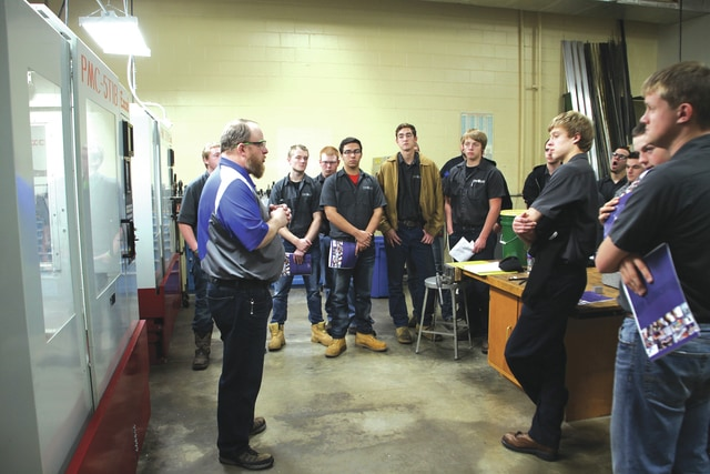 Provided photo Machining Technology students from Upper Valley Career Center listen to Bobby Gilbert, coordinatortTrainer of Industrial Programs, as he outlines Edison State's Advanced Manufacturing Systems program.