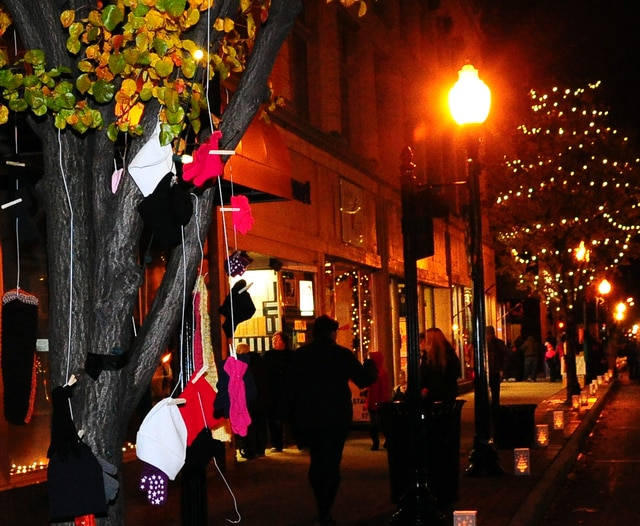 Mike Ullery | Daily Call Trees in downtown Piqua are filled with hats, gloves, and scarves, courtesy of St. James Church members. The items are free and available to those who need them to help keep warm during this winter season.