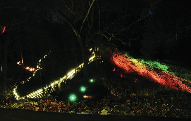 Mike Ullery | Daily Call The Miami County Park District welcomed visitors to their annual one-night event of lighting the falls at Charleston Falls Preserve. A sold-out crowd walked the paths, lit by candles, viewed the spectacular lighting, visited with Santa Claus and enjoyed a cup of hot chocolate.