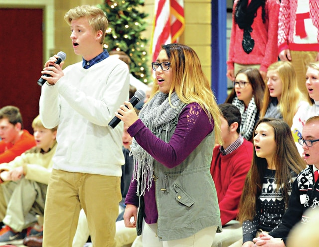 Mike Ullery | Daily Call Seniors Darby Wright and Kelsey Sotello perform with the Piqua High School Show Choir on Saturday morning at the annual Piqua City Schools Senior Citizens Breakfast at Washington Primary School.