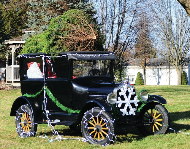 Mike Ullery   Daily Call An antique Ford car loaded with gifts and hauling a Christmas tree brings memories of Christmas past along Eldean Road near Piqua-Troy Road.