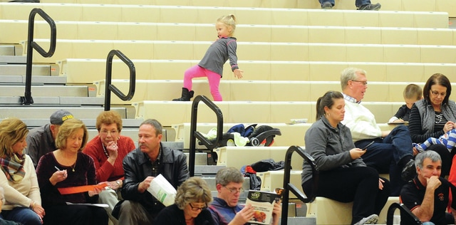 Mike Ullery | Daily Call Myla Thobe, 3, of Versailles shows off her dance moves in the stands during the Thursday's Versailles girls basketball game.