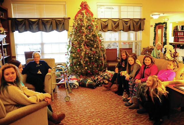 Mike Ullery | Daily Call Students from Piqua Central Intermediate School and Piqua Junior High School visit with residents at Brookdale of Piqua on Saturday before passing out handmade blankets the students made as part of teacher Becky Pottorf's Awesome Piqua grant.