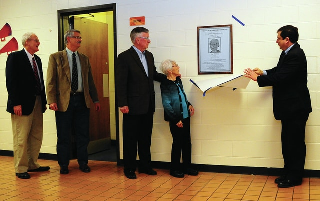 Mike Ullery | Daily Call Long-time Piqua City Schools educator Yuri Willcox reacts to the plaque unveiled in her honor in the commons area of Piqua High School on Monday. With Willcox are school board members Clint Bostick, Andy Hite, Bob Luby, and Frank Patrizio.