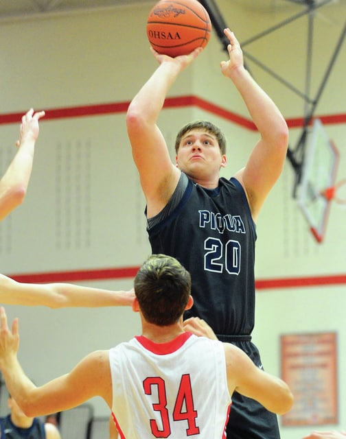 Mike Ullery | Daily Call Nate Monnin fires a three pointer over Tippecanoe's Adam Grieshop.