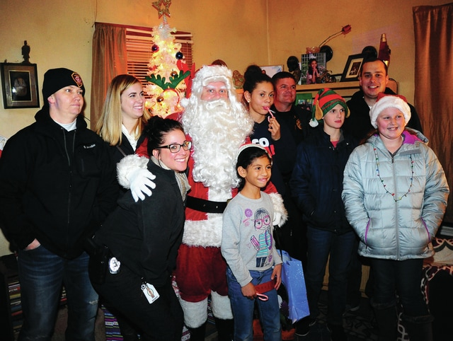 Mike Ullery | Daily Call Miami County FOP members and Miami County Victim Witness accompanied Santa Claus as he delivered gifts and meals to select members of the community who were in need of some extra Christmas cheer this year