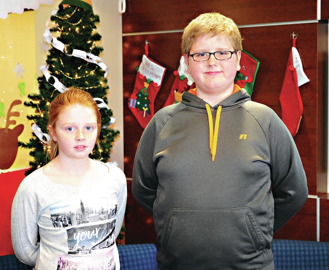 Mike Ullery | Daily Call Lucy Weiss, left, and Philip Rossman, right, were the top winner in Tuesday's Piqua Central Intermediate School Spelling Bee competition. Weiss, a fourth-grader, was runner-up and Rossman, a sixth grade student was school champion.