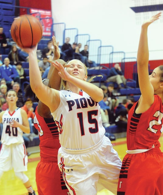 Mike Ullery   Daily Call Emily Powell, 15, is fouled as she goes up for a shot against Troy.