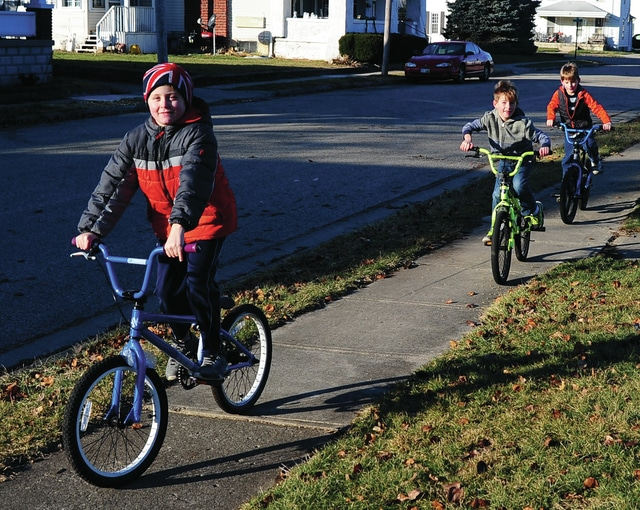 Mike Ullery | Daily Call Blake Walling, 9, along with twins Calvin and Charlie Sharwver, 7, take advantage of a beautiful Tuesday afternoon to ride their bicycles at Kiwanis Park.