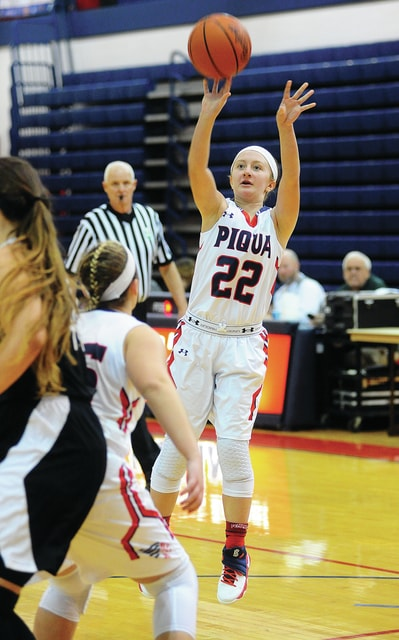 Mike Ullery | Daily Call Piqua's Kelsey Bachman puts up a jumper against Graham.