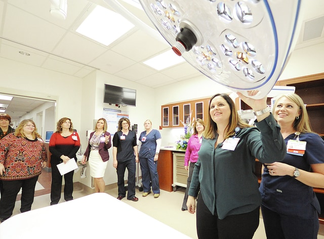 Anthony Weber | Troy Daily News Visitors went through the new Upper Valley Medical Center Emergency Department during an open house on Wednesday. Here, Heidi Harmer, nurse manager of the Emergency Department, discusses the trauma critical care room during the event, which was open to the public. According to Lisa Weaver, RN, director of the Emergency Department and Behavioral Health, the new department will take its first patient Monday at 7 a.m.