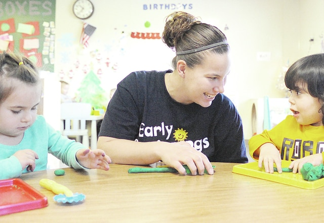 Anthony Weber | Troy Daily News Early Beginnings lead teacher Staci Contento uses shapes made of Play-Doh to work on fine motor sensory and fine motor skills with children in the young preschool classroom Tuesday at the center in Troy.