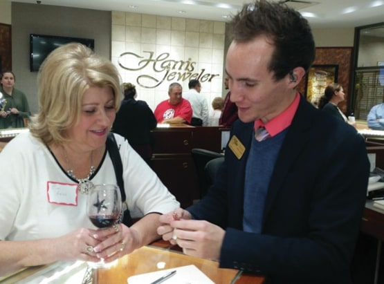 Provided photo A customer looks over one of the more than 1,500 rare LeVian jewels at Harris Jeweler during a recent fundraiser.